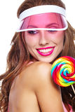 Beautiful woman eating big red lollipop in sun hat. Beautiful woman eating big  lollipop in sun hat on white background Stock Images