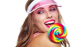 Beautiful woman eating big red lollipop in sun hat. Beautiful woman eating big  lollipop in sun hat on white background Royalty Free Stock Images