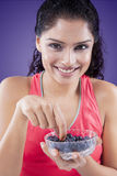 Beautiful Woman Eating Blueberries Royalty Free Stock Photography