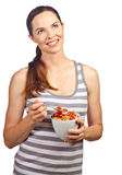 Beautiful woman eating a bowl of cereal Royalty Free Stock Photos