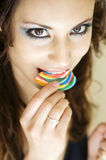 Beautiful woman eating candy lollipop Royalty Free Stock Images
