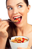 Beautiful woman eating cereal with strawberries Stock Photo
