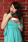 Beautiful woman eating cherry Stock Image