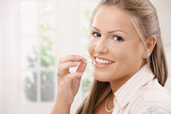 Beautiful woman eating chewing gum royalty free stock photo