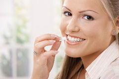 Beautiful woman eating chewing gum stock image