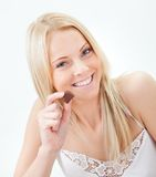 Beautiful woman eating chocolate Royalty Free Stock Photography