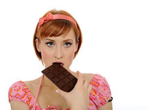 Beautiful woman eating chocolate bar.isolated Royalty Free Stock Photo