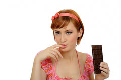Beautiful woman eating chocolate bar.isolated Stock Photos