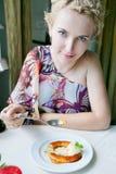 Beautiful woman eating dessert Stock Images