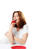 Beautiful woman eating fresh strawberry cake Royalty Free Stock Photo