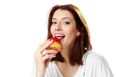 Beautiful woman eating fresh strawberry cake Royalty Free Stock Photography