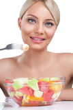 Beautiful woman eating fruit salad Royalty Free Stock Photography