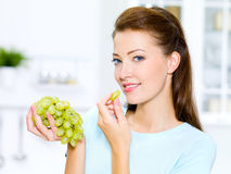 Beautiful woman eating  grapes Royalty Free Stock Images