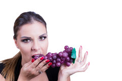 Beautiful  Woman eating grapes Royalty Free Stock Photography