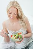 Beautiful woman eating green salad Royalty Free Stock Images