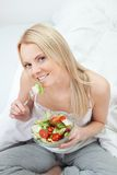 Beautiful woman eating green salad Stock Image