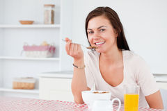 Beautiful woman eating her cereal Royalty Free Stock Images