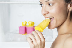 Beautiful woman eating ice cream Stock Images