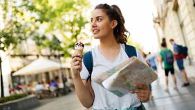 Beautiful woman eating ice cream outdoors Royalty Free Stock Photo
