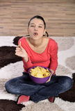 Beautiful woman eating junk food Royalty Free Stock Photography
