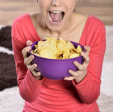 Beautiful woman eating junk food Royalty Free Stock Image