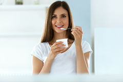 Beautiful Woman Eating Organic Yogurt. Healthy Diet Nutrition Stock Image
