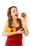 Beautiful woman eating peppers Royalty Free Stock Photography