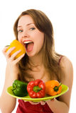 Beautiful woman eating peppers Stock Image