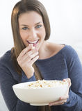 Beautiful Woman Eating Popcorn At Home Stock Image