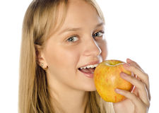 Beautiful woman eating red apple Stock Image