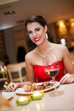 Beautiful woman eating in restaurant Stock Images