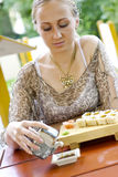 Beautiful woman eating sushi. Stock Photography