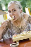 Beautiful woman eating sushi. Stock Photos