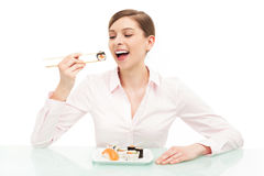 Beautiful woman eating sushi Royalty Free Stock Photo
