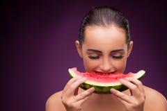 The beautiful woman eating tasty watermelon Stock Photos