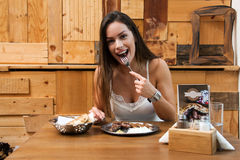 Beautiful woman eating traditional Balkan dish Royalty Free Stock Photos