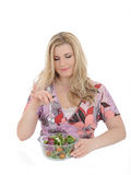 Beautiful woman eating vegetable salad royalty free stock photography