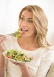 Beautiful Woman Eating Vegetable Salad Royalty Free Stock Photo