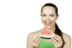 Beautiful woman eating water melon Royalty Free Stock Photos
