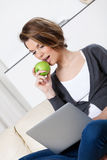 Beautiful woman eats a green apple Royalty Free Stock Photo