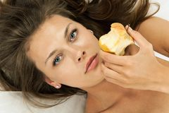 Beautiful woman eatting an apple Stock Photos