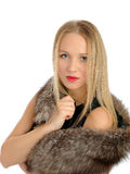 Beautiful woman in elegant animal fur jacket Stock Image