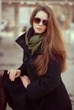 Beautiful woman in an elegant black coat Royalty Free Stock Images