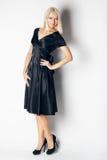 Beautiful woman in elegant silk dress in  fashion pose. Stock Photos