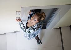 Beautiful woman in the elevator Stock Image