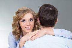 Beautiful woman embracing her boyfriend Royalty Free Stock Photos