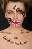 Beautiful woman with english symbols on her face Royalty Free Stock Image