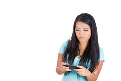 A beautiful woman engrossed in her mobile phone Royalty Free Stock Images