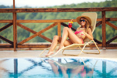 Beautiful woman enjoing by the swimming pool Royalty Free Stock Photography