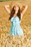 Beautiful woman enjoy in field of wheat Stock Photos